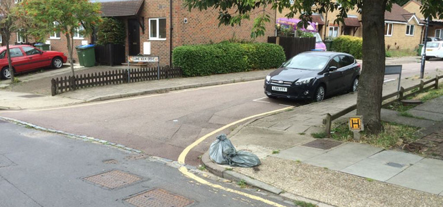 Council sweepers' bags left out in Highcombe, Charlton - a well-known flytipping hotspot